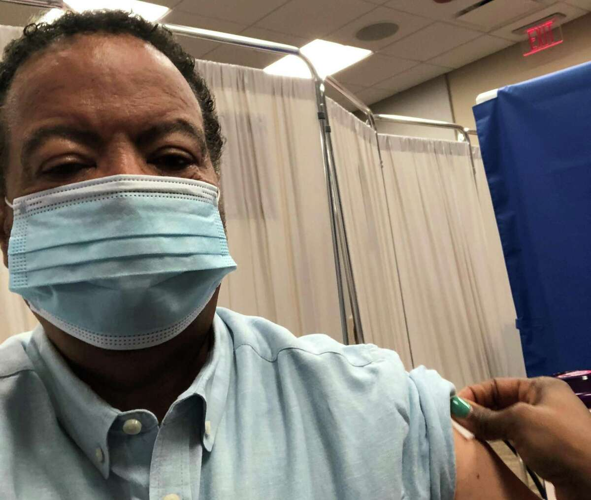Roderic Pettigrew, CEO of Engineering Health and executive dean of Engineering Medicine (EnMed) at Texas A&M University and Houston Methodist Hospital, receives the COVID vaccine.