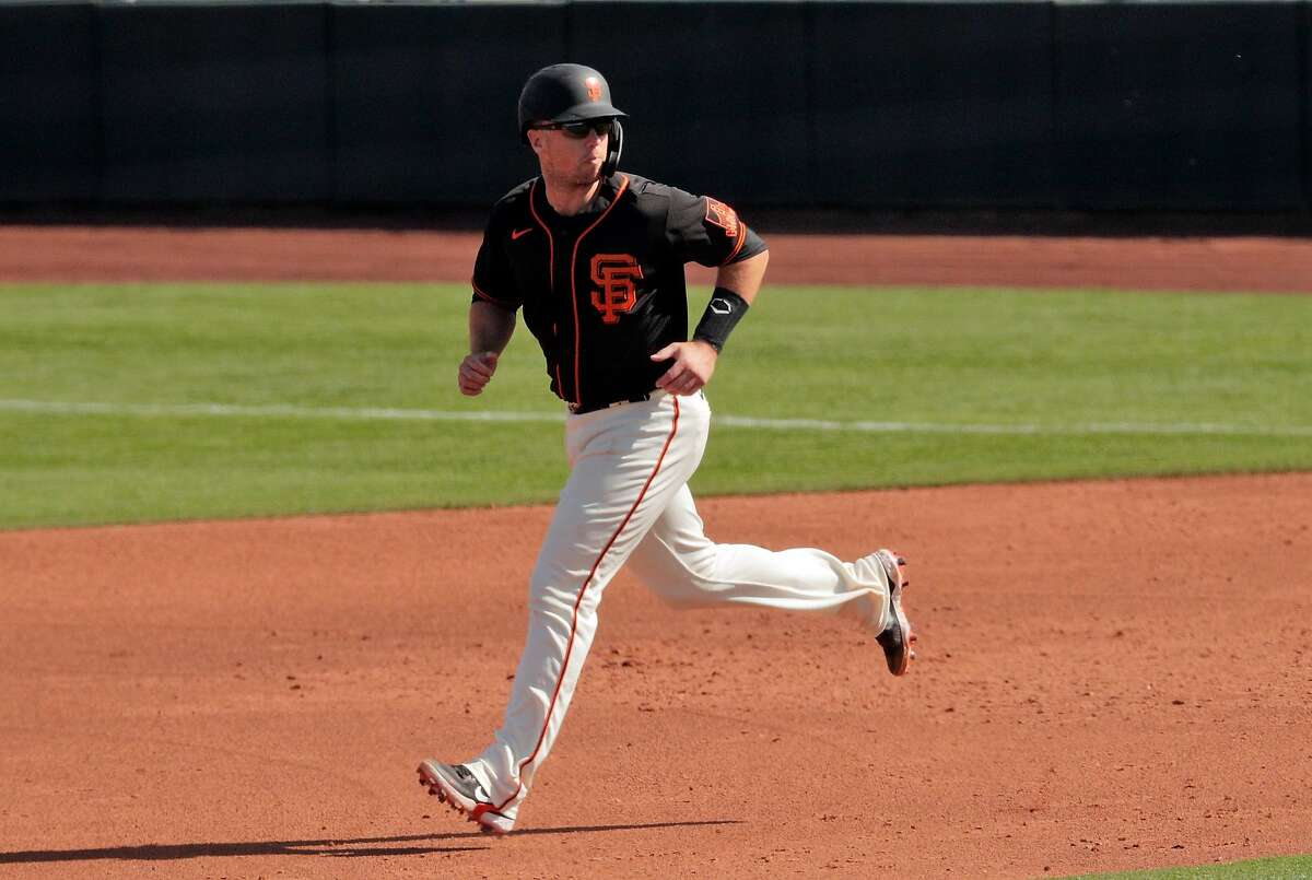 Buster Posey (28) takes second base on a wild pitch in the third inning as the San Francisco Giants played the Los Angeles Angels at Scottsdale Stadium in Scottsdale, Ariz., on Sunday, February 28, 2021.