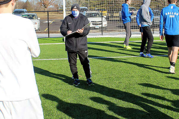 New Marquette Catholic high boys soccer coach Jerry DiSalvo organizes his team's first official preseason practice Monday at Gordon Moore Park. DiSalvo replaces Tim Gould, who left to become athletic director at Decatur MacArthur High School.