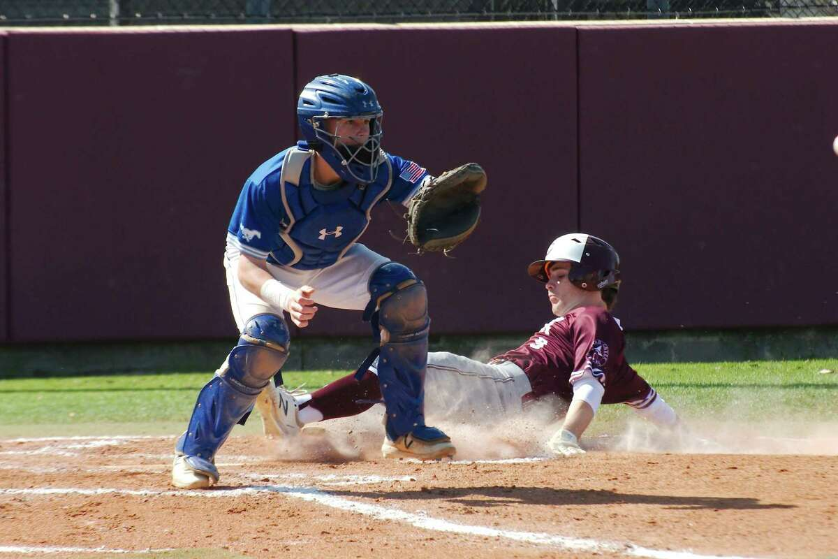 Lane Brewster, shown sliding home, helped Clear Creek stage a six-run rally in the seventh inning as the Wildcats defeated Brazoswood, 10-9, Thursday night.