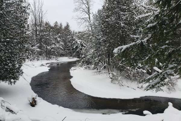 Columnist Janet Stroup writes about listening to silence, especially in nature. This photo shows a snowy scene from February at a bend in Bear Creek in Brethren. (Arielle Breen/News Advocate)