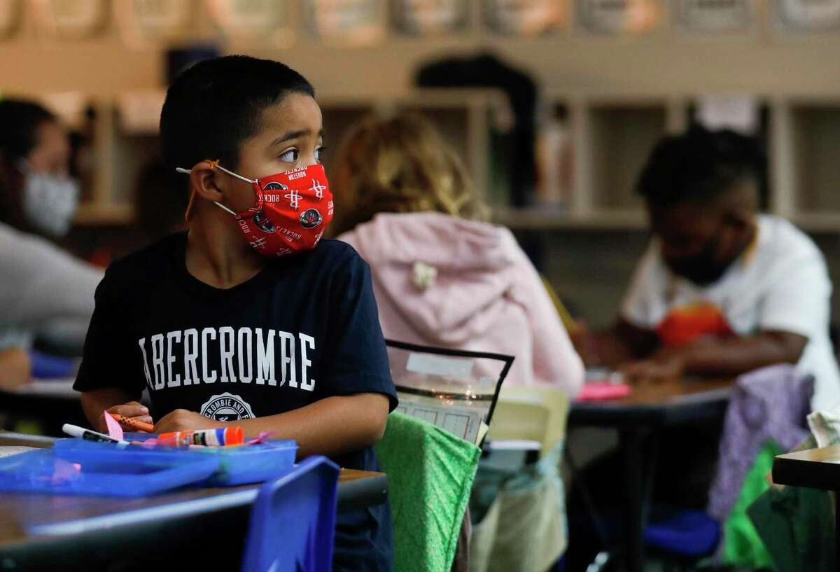 Kindergartener Joel Salazar wears a face mask as he works at his desk at William Loyd Meador Elementary School, Thursday, Sept. 10, 2020, in Willis. .