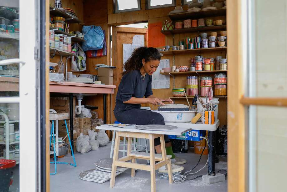 Chinzalée Sonami, owner and ceramist of Pala Ceramics, trims a piece in her Oakland studio. Photo: Gabrielle Lurie / The Chronicle