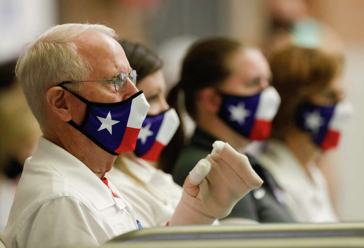 """Judges wear Texas-themed face masks during the girls 1-meter diving during the UIL State Swimming & Diving Championships Monday, March 1, 2021, in San Antonio. Montgomery County Judge Mark Keough was """"very pleased"""" with Gov. Greg Abbott's announcement Tuesday lifting a statewide mask mandate related to the COVID-19 pandemic and no longer limiting the number of diners restaurants can serve indoors."""