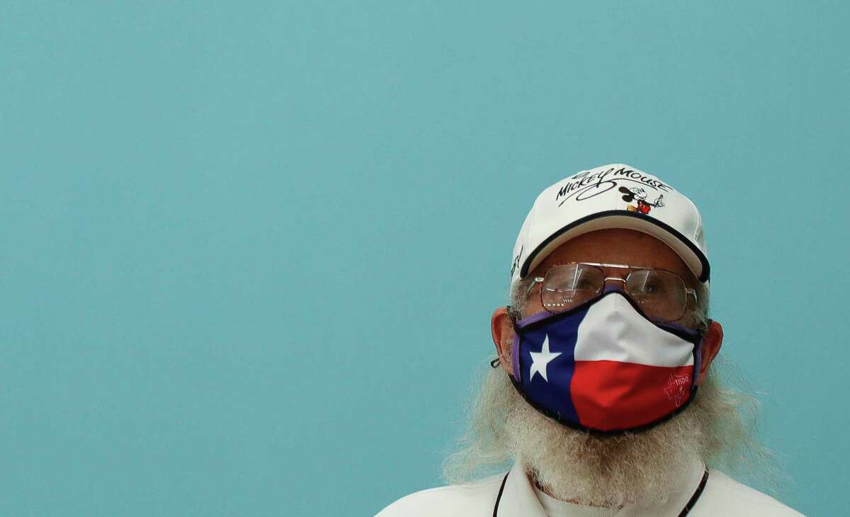 """A man wears a Texas-themed face mask during the UIL State Swimming & Diving Championships, Monday, March 1, 2021, in San Antonio. Montgomery County Judge Mark Keough was """"very pleased"""" with Gov. Greg Abbott's announcement Tuesday lifting a statewide mask mandate related to the COVID-19 pandemic and no longer limiting the number of diners restaurants can serve indoors."""