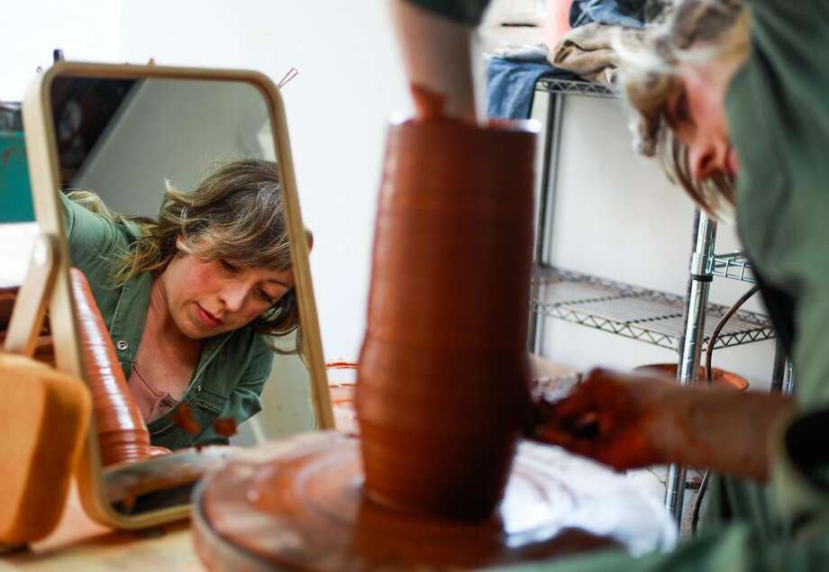 Erin Hupp of Erin Hupp Ceramics makes a vase in her East Bay studio. Photo: Gabrielle Lurie / The Chronicle