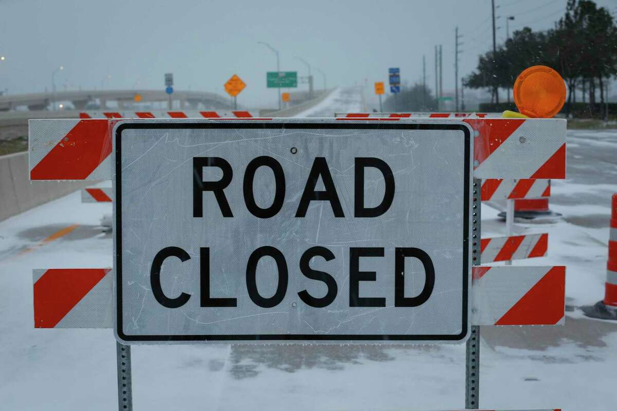 The entrance ramp to SH 288 is closed due to slick conditions Monday, Feb. 15, 2021, in Pearland.
