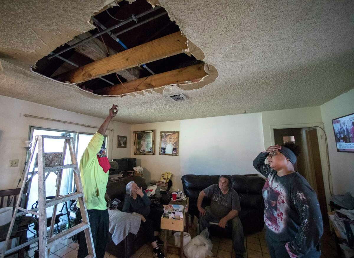 Riz Giwa shows where he repaired a pipe that burst and that there may be another leaky pipe in Humberto and Olga Lopez's home Tuesday, March 2, 2021 in Houston. Giwa was sent to the Lopez home by The Relief Gang, founded by rap artist Trae Tha Truth and DJ Mr. Rogers, a hip hop DJ, who are continuing to work in helping people in the community get back on their feet following the severe winter storm that froze pipes that burst into homes all over the city. They said they have 698 homes on their list of residences the organization is working with local plumbers in getting to them to make repairs.