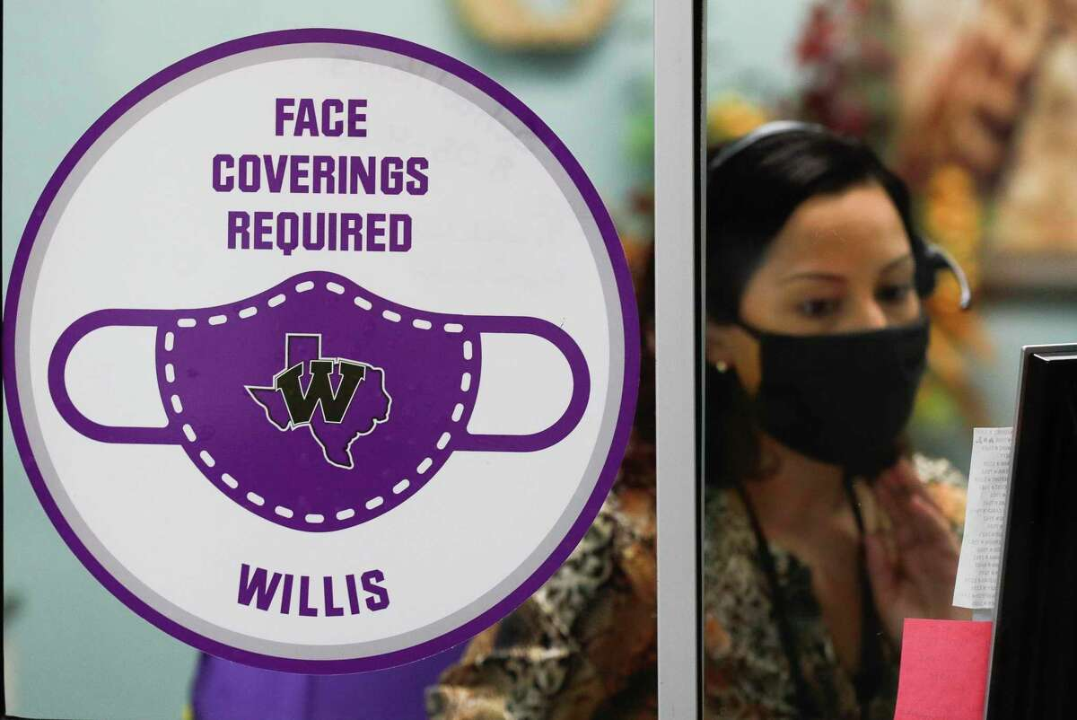 A sign reminds visitors that face masks are required at William Loyd Meador Elementary School Sept. 10 in Willis. School district across Montgomery County reacted Tuesday to the announcement from Gov. Greg Abbott that he was ending the state's coronavirus restrictions, including the mask mandate. District officials said they were waiting for more guidance from the Texas Education Agency.