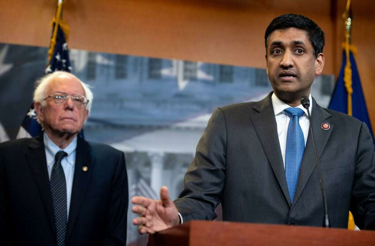 US Representative Ro Khanna (R), Democrat of California, and US Senator Bernie Sanders, Independent of Vermont, speak during a press conference following a vote in the US House on ending US military involvement in the war in Yemen, on Capitol Hill in Washington, DC, April 4, 2019.