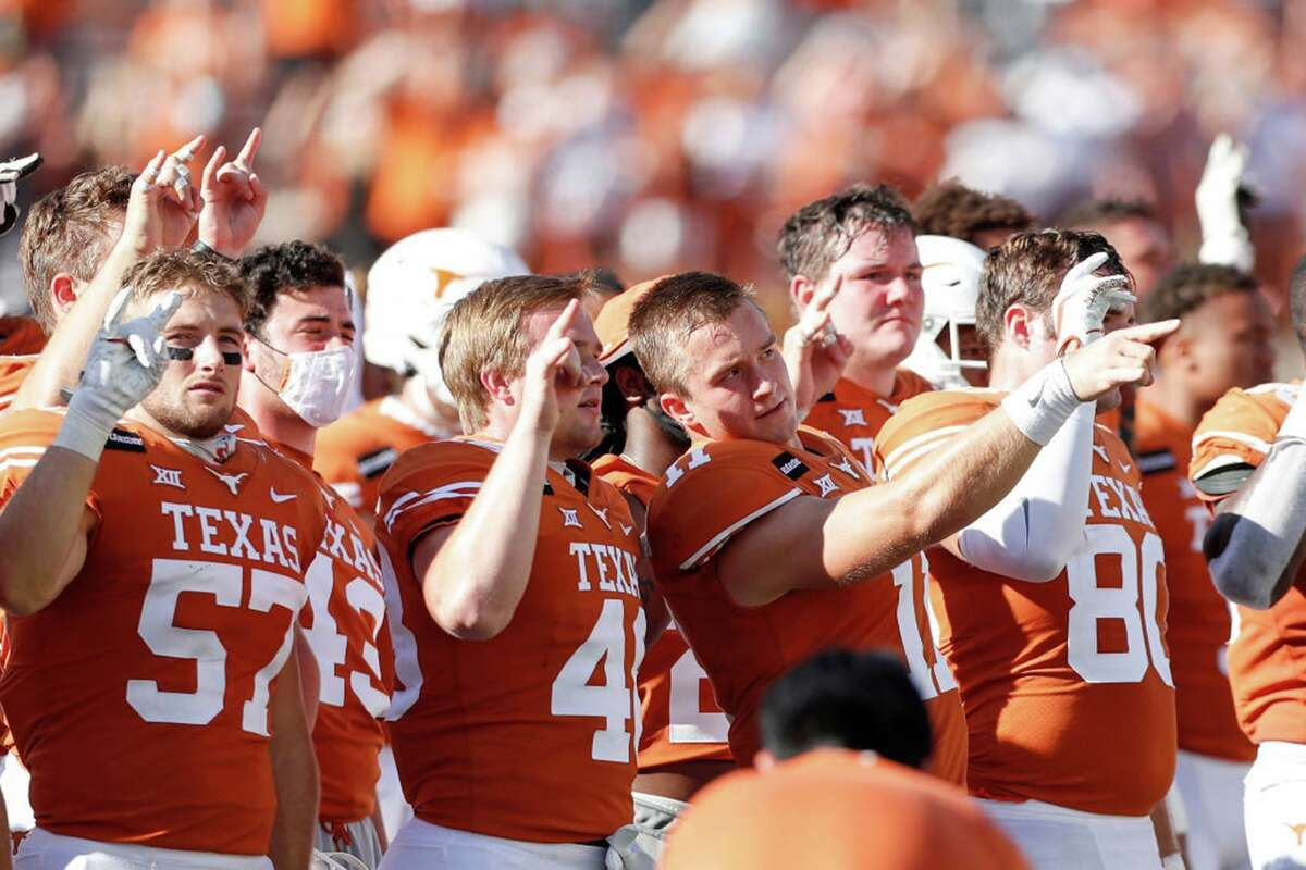 The Texas Longhorns stand for The Eyes of Texas after the game against the West Virginia Mountaineers at Darrell K Royal-Texas Memorial Stadium on November 7, 2020 in Austin, Texas. (Photo by Tim Warner/Getty Images/TNS)