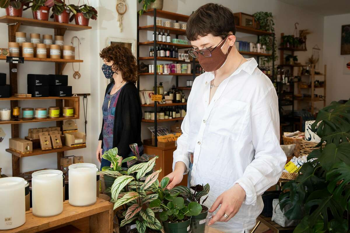 Julia Ravella (right) and shop owner Alissa Anderson work to organize products on the shelves of Foggy Notion on Clement Street in San Francisco, Calif. Tuesday, March 2, 2021.