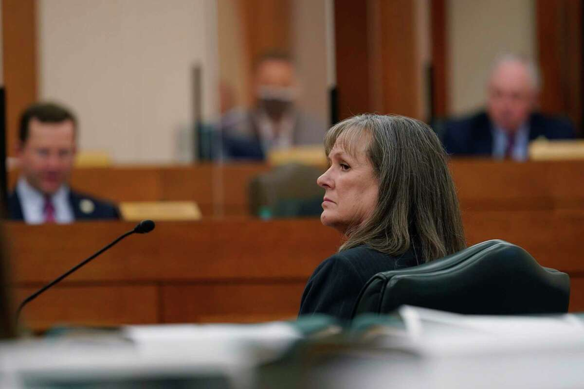 DeAnn Walker, Chairman of the Public Utility Commission of Texas, testifies as the Committees on State Affairs and Energy Resources holds a joint public hearing to consider the factors that led to statewide electrical blackouts, Saturday, Feb. 27, 2021, in Austin, Texas. The hearings were the first in Texas since a blackout that was one of the worst in U.S. history, leaving more than 4 million customers without power and heat in subfreezing temperatures. (AP Photo/Eric Gay)