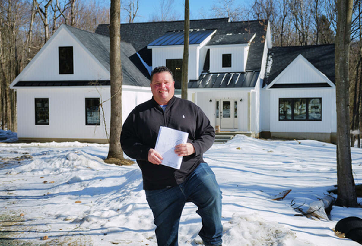 Jeff McDonald, owner of McDonald Custom Homes, stands outside one of homes he designed and built in the Tabor Woods subdivision on Tuesday, March 2, 2021, in the Town of Halfmoon. McDonald started and finished the house during the pandemic. (Paul Buckowski/Times Union)