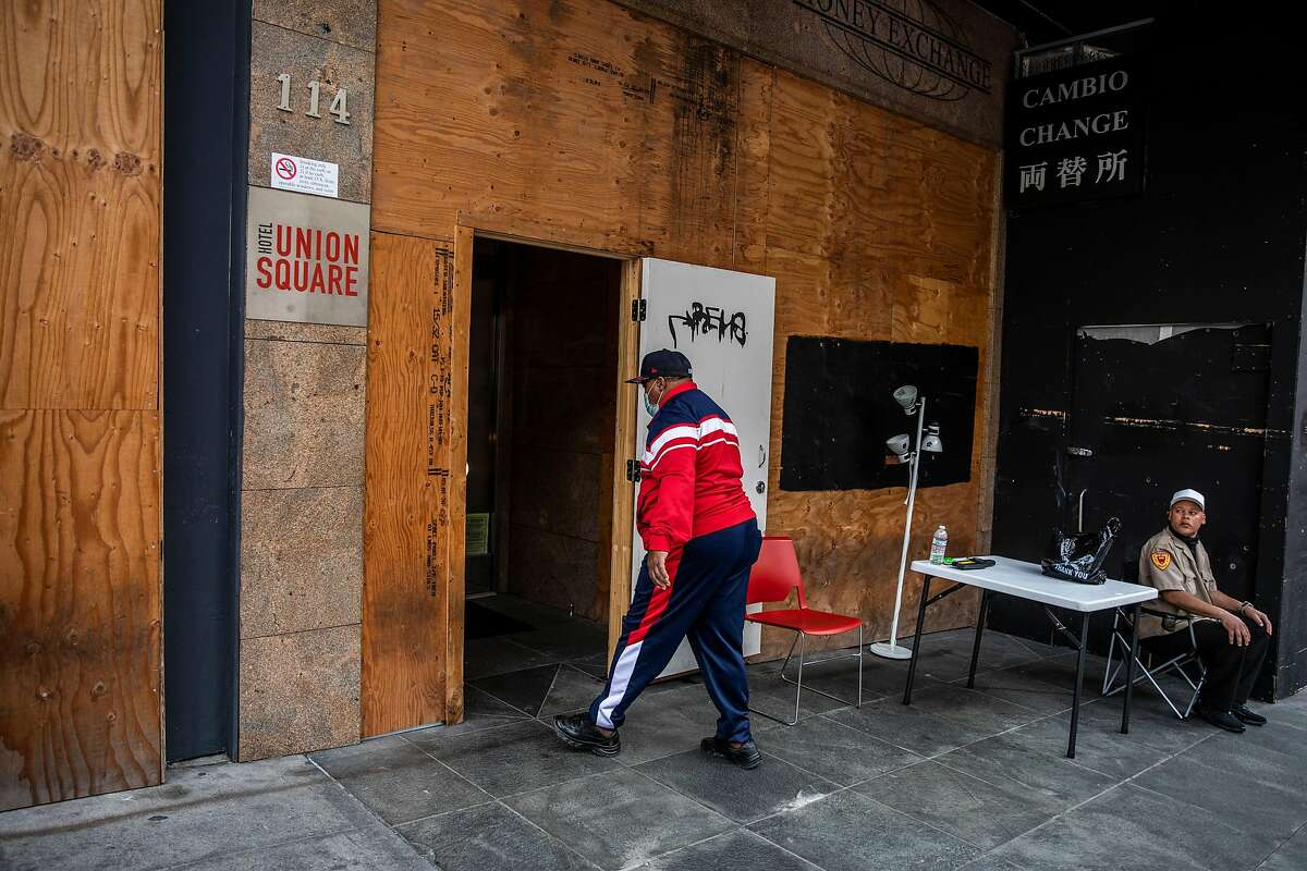 Marlin Tanner enters the shelter-in-place hotel near Union Square in San Francisco, where he has been living after being injured in a drive-by shooting while living in his car in the Bayview district.