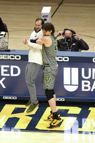 MORGANTOWN, WV - MARCH 02: Matthew Mayer #24 of the Baylor Bears celebrates a overtime win with head coach head coach Scott Drew after during a college basketball game against the Baylor Bears at WVU Coliseum on March 2, 2021 in Morgantown, West Virginia. Photo: Mitchell Layton, Getty Images / 2021 Getty Images