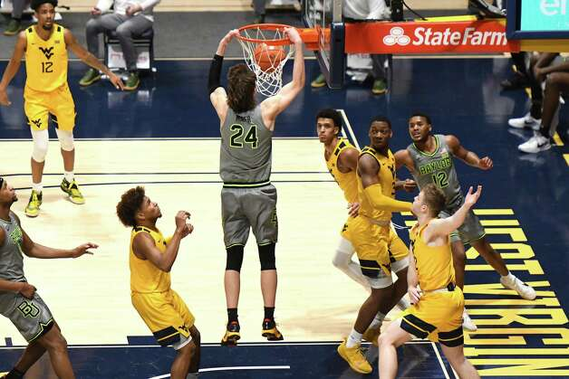 MORGANTOWN, WV - MARCH 02:  Matthew Mayer #24 of the Baylor Bears dunks the ball in the second half during a college basketball game against the West Virginia Mountaineers at WVU Coliseum  on March 2, 2021 in Morgantown, West Virginia. Photo: Mitchell Layton, Getty Images / 2021 Getty Images