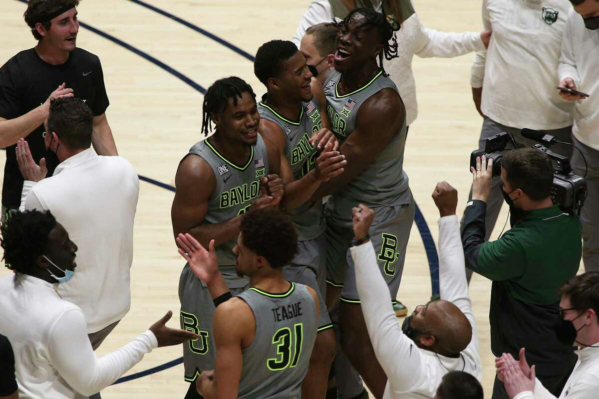 Baylor players celebrate the program's first conference championship since 1950 after Tuesday's overtime win at West Virginia to take the Big 12 crown.