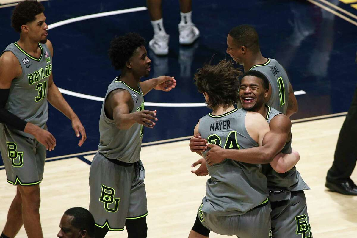 Baylor players celebrate an overtime win over West Virginia on Tuesday that clinched the Big 12 championship, the first conference title for the program since 1950.