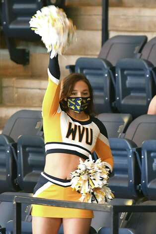 MORGANTOWN, WV - MARCH 02:  A West Virginia Mountaineers cheerleader performs during a college basketball game against the Baylor Bears at WVU Coliseum  on March 2, 2021 in Morgantown, West Virginia. Photo: Mitchell Layton, Getty Images / 2021 Getty Images
