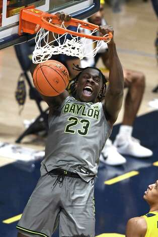 MORGANTOWN, WV - MARCH 02:  Jonathan Tchamwa Tchatchoua #23 of the Baylor Bears dunks the ball in the first half during a college basketball game against the West Virginia Mountaineers at WVU Coliseum  on March 2, 2021 in Morgantown, West Virginia. Photo: Mitchell Layton, Getty Images / 2021 Getty Images