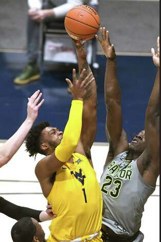MORGANTOWN, WV - MARCH 02:  Derek Culver #1 of the West Virginia Mountaineers takes a shot over Jonathan Tchamwa Tchatchoua #23 of the Baylor Bears in the first half during a college basketball game at WVU Coliseum  on March 2, 2021 in Morgantown, West Virginia. Photo: Mitchell Layton, Getty Images / 2021 Getty Images