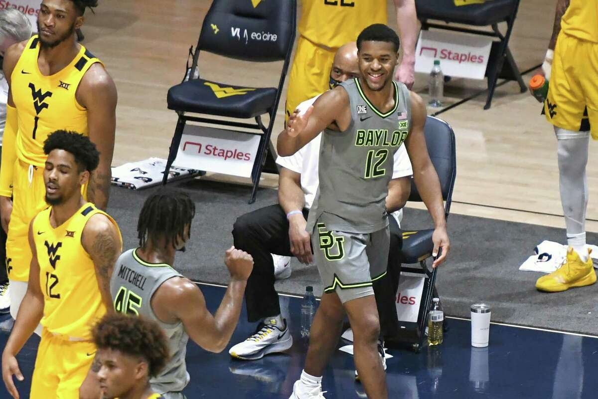 MORGANTOWN, WV - MARCH 02: Jared Butler #12 of the Baylor Bears celebrates a three point at end of the first half during a college basketball game against the West Virginia Mountaineers at WVU Coliseum on March 2, 2021 in Morgantown, West Virginia.