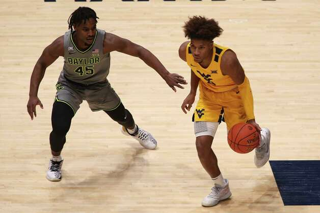 West Virginia guard Miles McBride (4) is defended by Baylor guard Davion Mitchell (45) during the first half of an NCAA college basketball game Tuesday, March 2, 2021, in Morgantown, W.Va. (AP Photo/Kathleen Batten) Photo: Kathy Batten, Associated Press / Copyright 2021 The Associated Press. All rights reserved