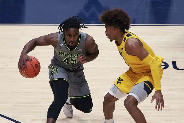 Baylor guard Davion Mitchell (45) is defended by West Virginia guard Miles McBride during the first half of an NCAA college basketball game Tuesday, March 2, 2021, in Morgantown, W.Va. (AP Photo/Kathleen Batten) Photo: Kathy Batten, Associated Press / Copyright 2021 The Associated Press. All rights reserved