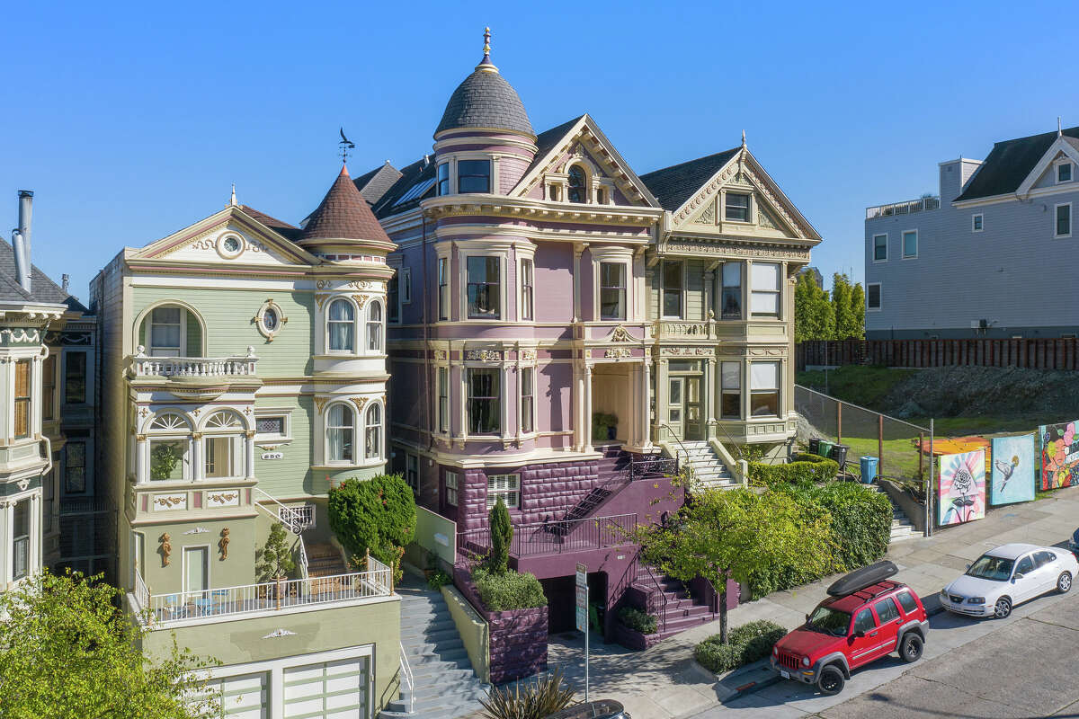 The stately mansion is both part of S.F.'s iconic views in addition to delivering them, looking out on Alamo Square in front and showcasing the city skyline in back.