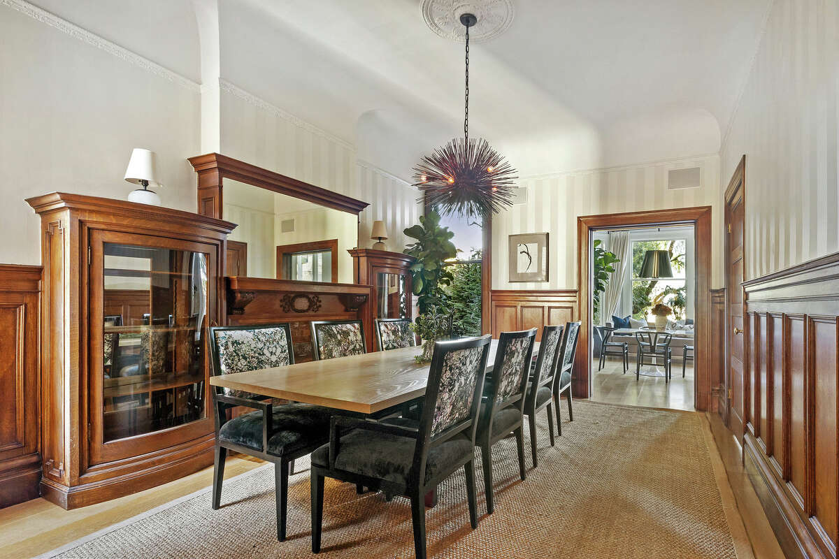 Inside, the formal dining room shows a blend of original features and luxurious upgrades.