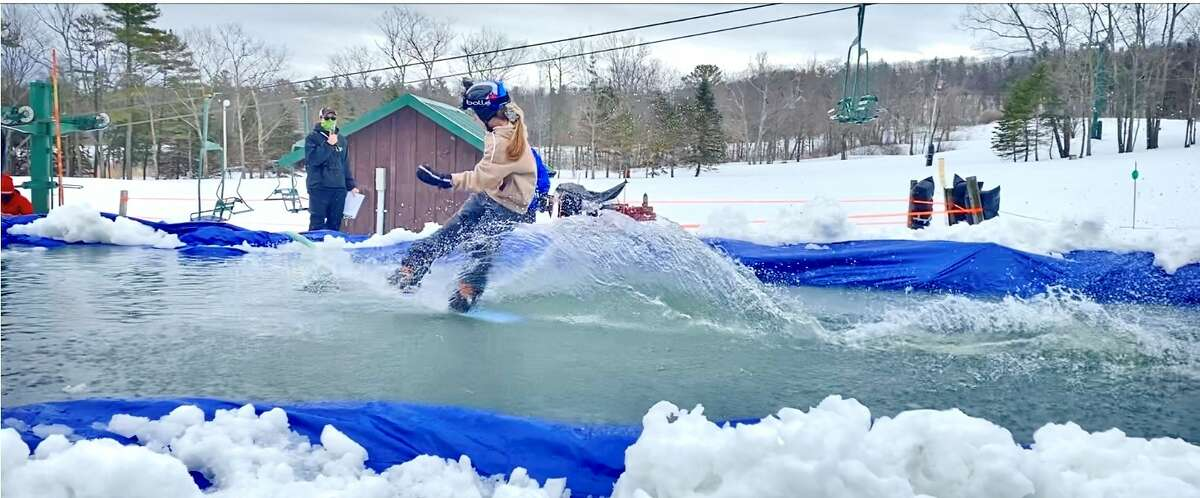 At last weekend's Maple Ski Ridge Pond Skim, skiers and snowboarders ran down the slopes and tried to make it across the pond without swimming. Both professionals and beginners competed for their turn against the water. Here, Rayn Skwarlo attempting the pond, in this photo from Gary Skwarlo.