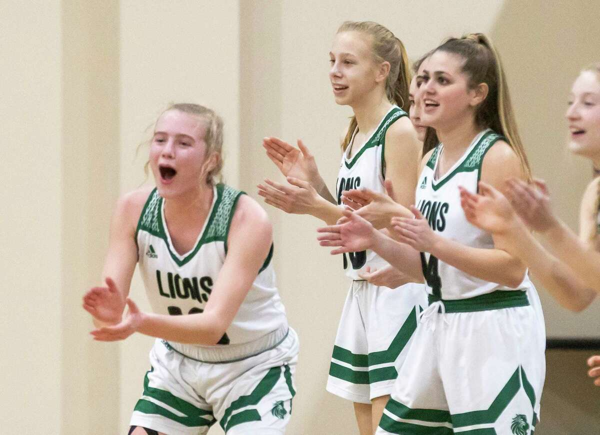 Legacy Preparatory Christian Academy basketball girls react after their team scores during the first quarter of a TAPPS Class 4A Area girls basketball game against Westbury Christian at Legacy Preparatory Christian Academy, Tuesday, March 02, 2021, in Magnolia.