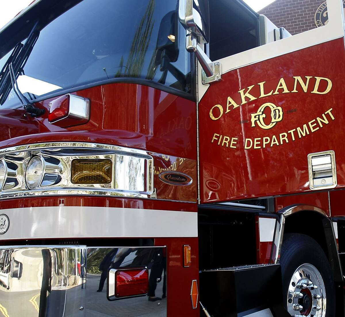This file photograph shows an Oakland Fire Department engine outside of a fire station in Oakland.