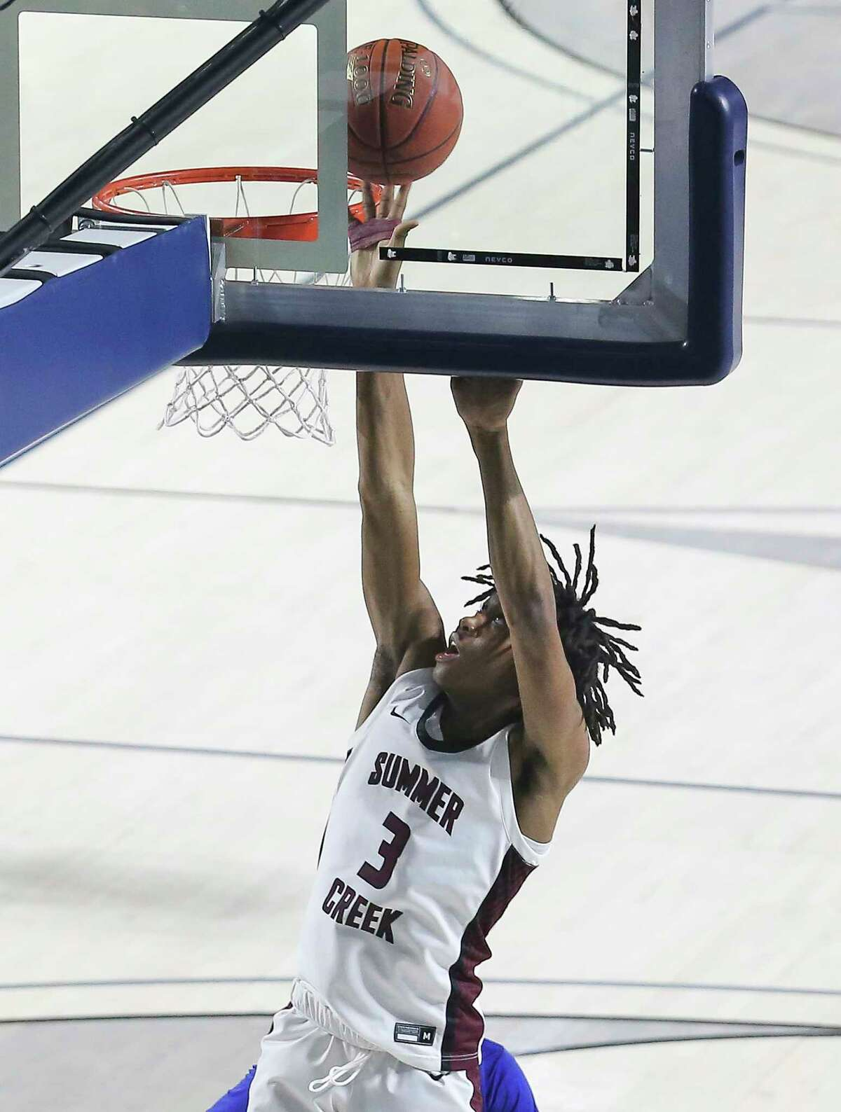 Summer Creek's JaKeel Registe scores a basket during the fourth quarter of a UIL 6A Region III Boys Basketball Playoffs Semifinal game against Elkins Tuesday, March 2, 2021, at Delmar Fieldhouse in Houston.