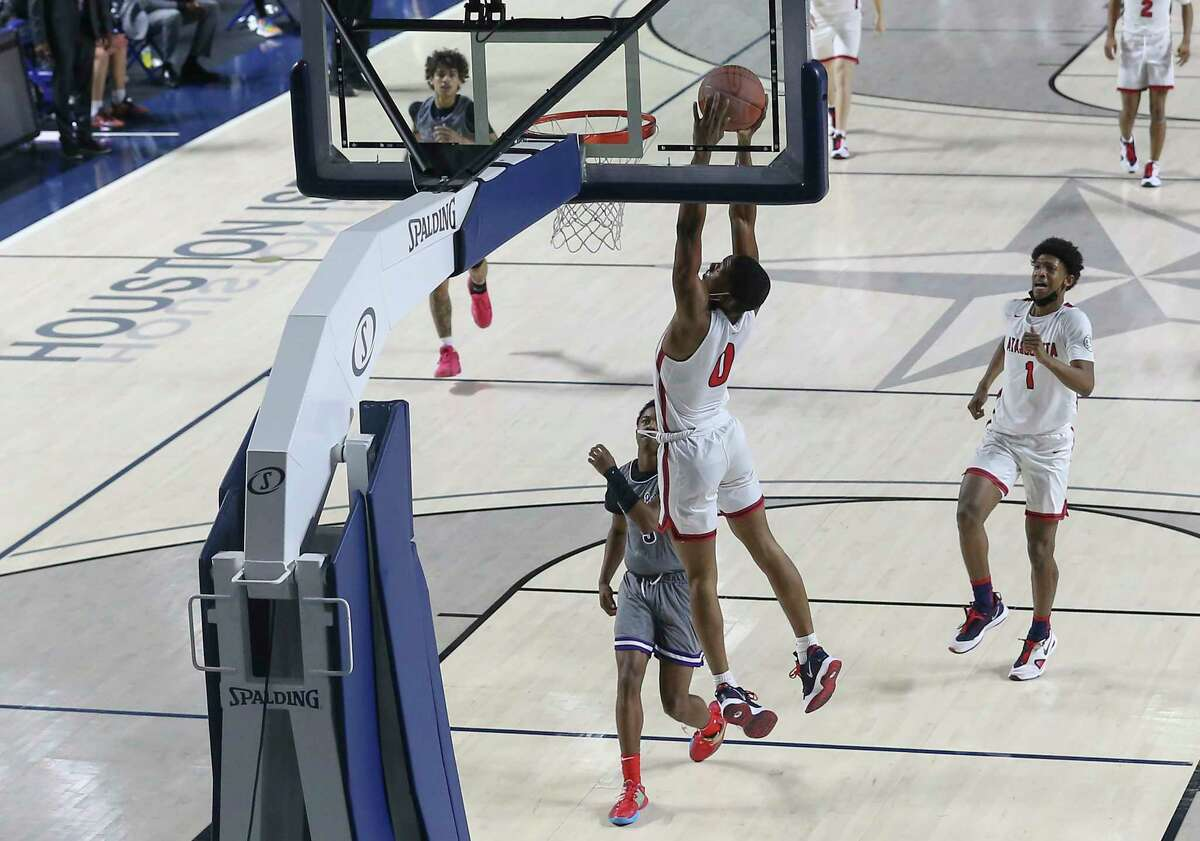 Atascocita guard Tom Hart III (0) puts the ball into the basket during the third quarter of a UIL 6A Region III Boys Basketball Playoffs game against Ridge Point Tuesday, March 2, 2021, at Delmar Fieldhouse in Houston.