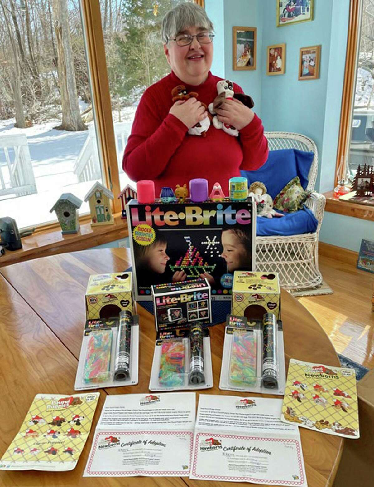 Irene Racette, with the contents of the package sent by Hasbro as a result of her innovative use of the Lite Brite device.