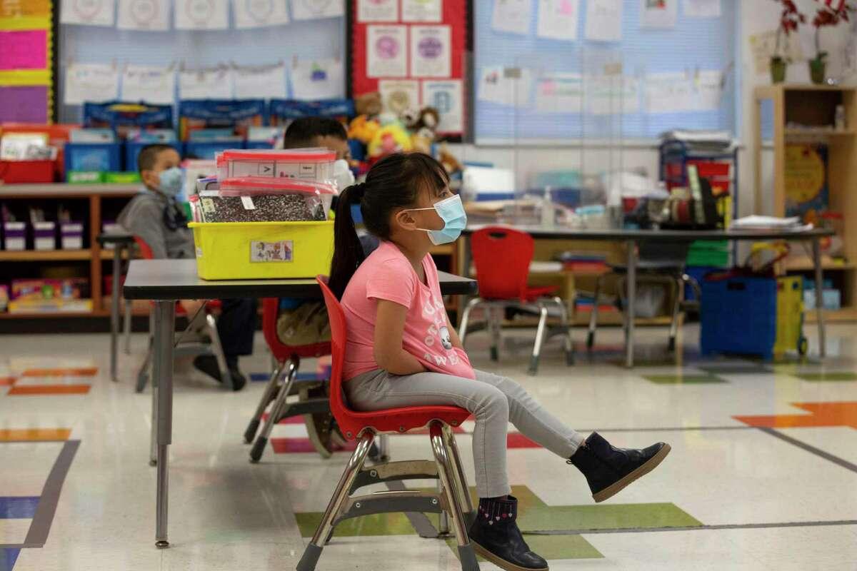 James DeAnda Elementary School student listens to English teacher Evangeline Gabriel during a class Tuesday, Feb. 9, 2021, in Houston.