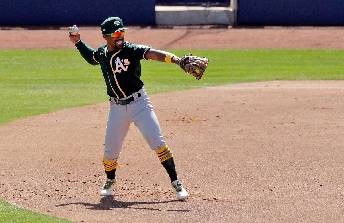 Tony Kemp (5) throws the ball around the infield between batters as the Oakland Athletics played the Milwaukee Brewers at American Family Fields in Phoenix, Ariz., on Tuesday, March 2, 2021.