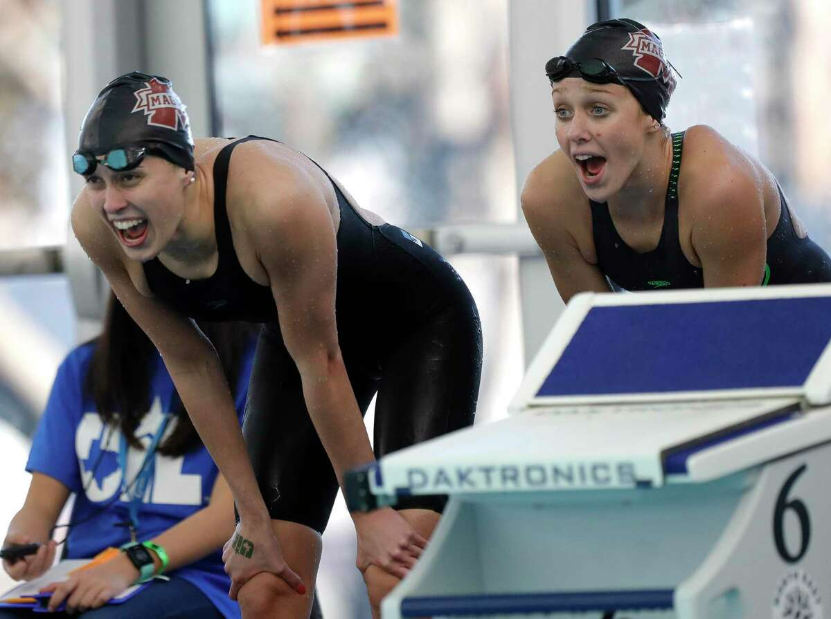 Magnolia swimmers cheer as they compete in the Class 5A girls 200-yard medley relay during the UIL State Swimming & Diving Championships, Tuesday, March 2, 2021, in San Antonio.