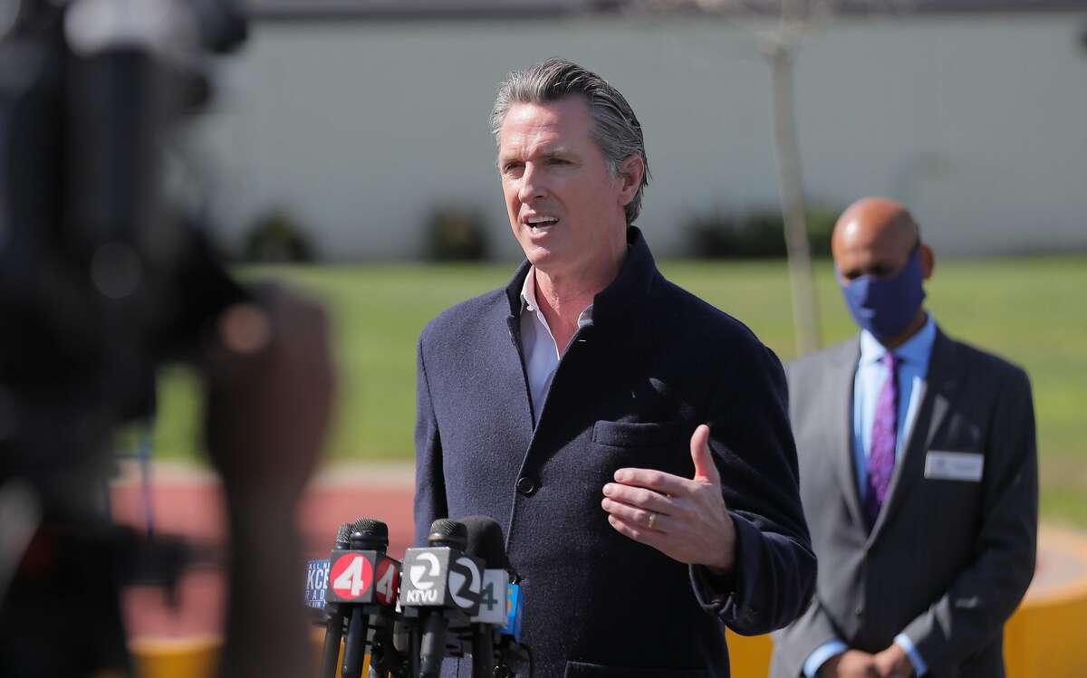 Gov. Gavin Newsom talks to reporters at Barron Park Elementary School in Palo Alto.