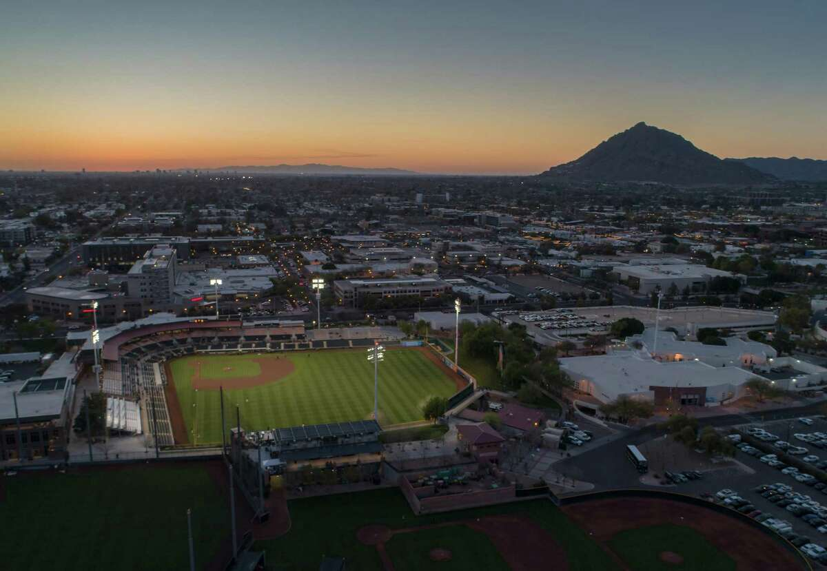 The stadium lights came on just before the San Francisco Giants played the Los Angeles Dodgers at Scottsdale Stadium during a spring training game in Scottsdale, Ariz., on Tuesday, March 2, 2021.