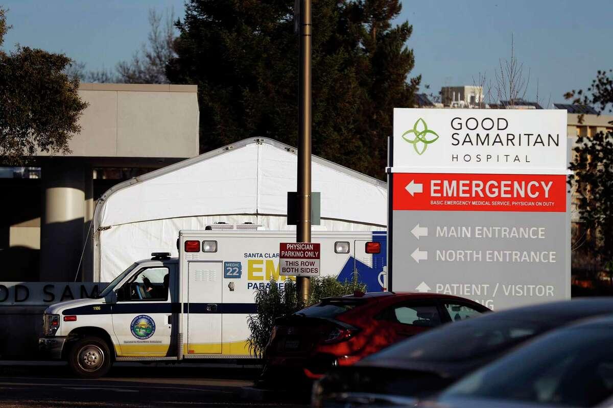 An ambulance waits outside the emergency room entrance at Good Samaritan Hospital in San Jose on Jan. 7 during a surge on coronavirus cases.