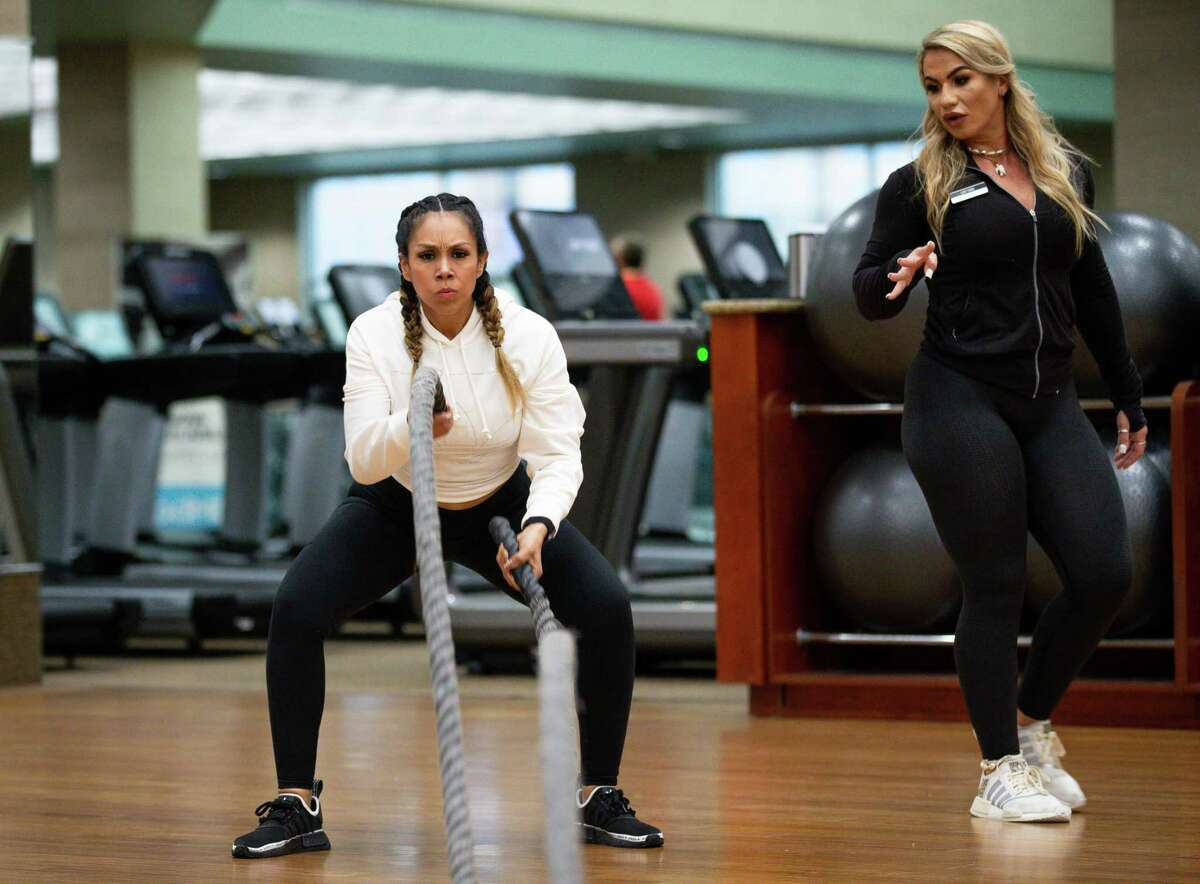 Nancy Mora, left, spends some time with the battle ropes during a training session with her trainer Jessica Truxton at Life Time Fitness on Monday, March 1, 2021, in Houston. Mora decided to make health a priority and started with Life Time in 2018. Since then, she's lost body fat and gained muscle mass. She contracted the COVID-19 virus a few months ago and credits her speedy recovery with her transformation, believing her immune system was optimal due to nutrition and fitness.