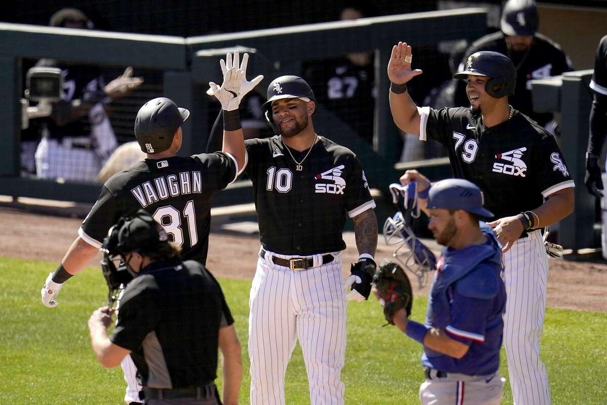 The White Sox' Andrew Vaughn, the former Cal first baseman, celebrates his three-run home run against the Texas Rangers with teammates Yoan Moncada (10) and Jose Abreu (79).