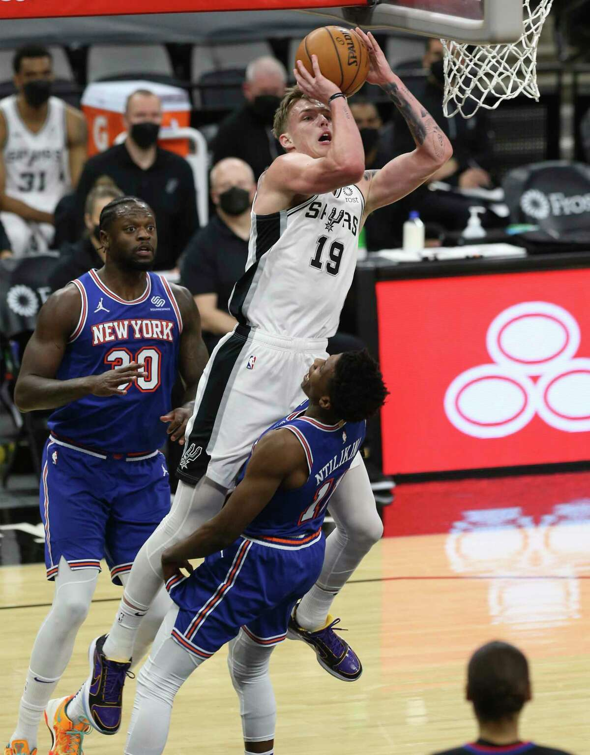 Spurs' Luka Samanic (19) commits a charge against New York Knicks' Frank Ntilikina (11) at the AT&T Center on Tuesday, Mar. 2, 2021.
