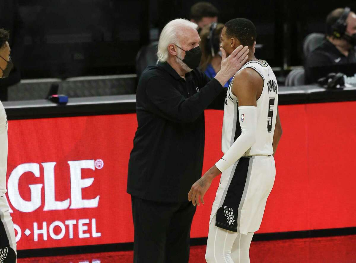 Spurs coach Gregg Popovich shows his approval of the performance by Dejounte Murray (05) against the New York Knicks at the AT&T Center on Tuesday, Mar. 2, 2021. Spurs defeated the Knicks, 119-93. Murray scored 17 points for the game.