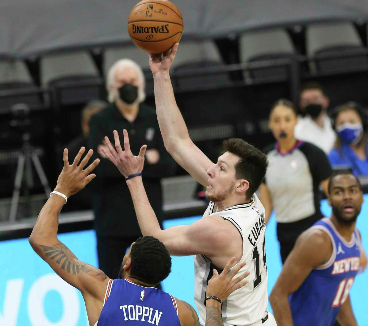 Spurs' Drew Eubanks (14) shoots against New York Knicks' Obi Toppin (01) at the AT&T Center on Tuesday, Mar. 2, 2021.