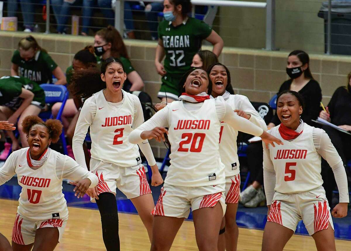 The Judson Rockets celebrate after their 58-52 victory over Reagan in the Region IV-6A Regional Championship game at the Northside Sports Gym on Tuesday, March 2, 2021.