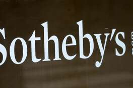 PARIS, FRANCE - JUNE 17: The logo of the auction house Sotheby's is displayed on the facade of the Rue Faubourg St Honore shop on June 17, 2019 in Paris, France. The French businessman Patrick Drahi bought the famous auction house Sotheby's for 3.7 billion dollars (3.3 billion euros), it was reported Monday, June 17. Sotheby's is the oldest art auction group in the world. It is in addition to the holdings of the largest shareholder in the European telecoms and media group Altice.(Photo by Chesnot/Getty Images)